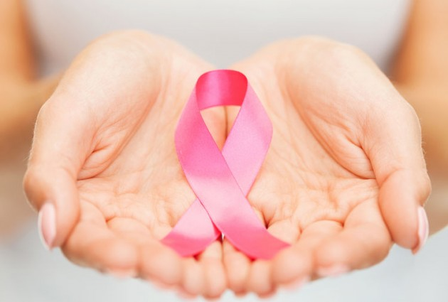28635002 - healthcare and medicine concept - womans hands holding pink breast cancer awareness ribbon