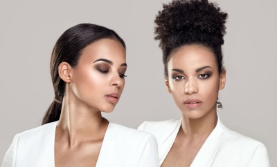 78313604 - two elegant young african american women posing together.